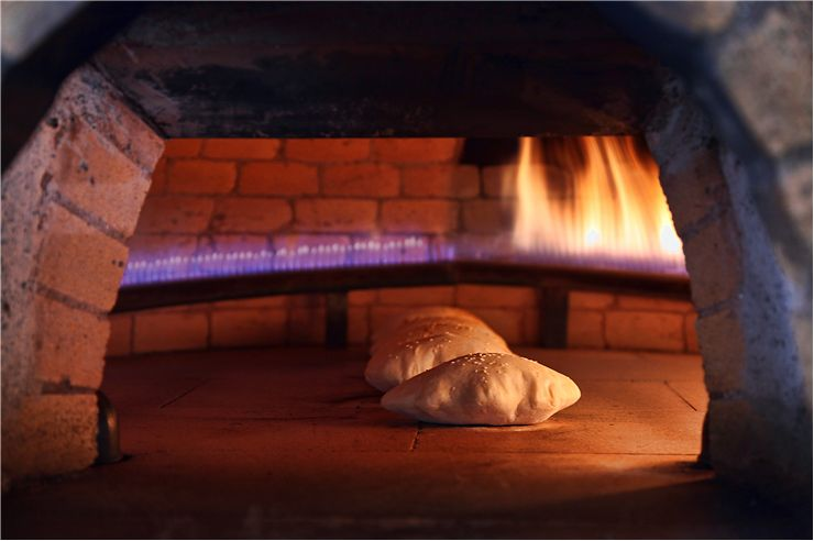 Picture - Baked Bread in Brick Oven
